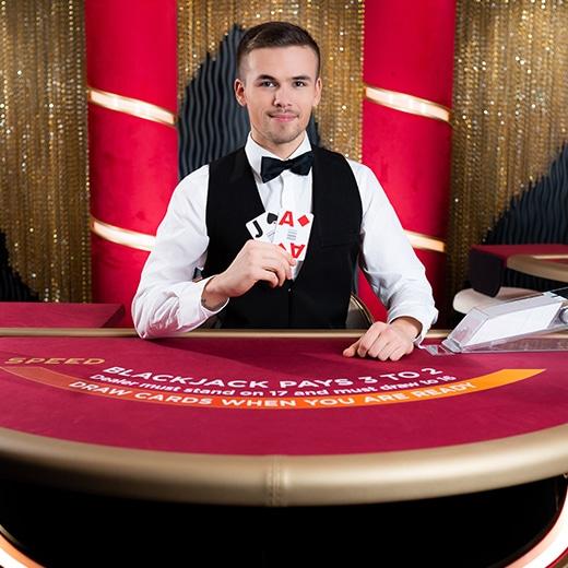 Blackjack live dealer holding cards