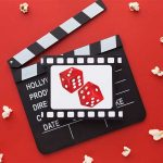 Movie track, popcorns, and two dice