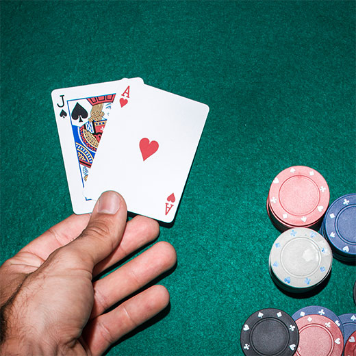 Man playing blackjack on the blackjack table