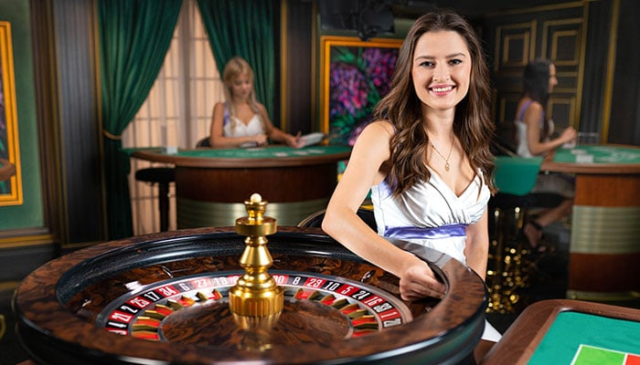 Roulette wheel with live dealer