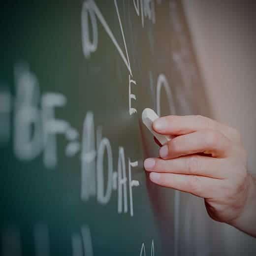 Teacher writing down math formula